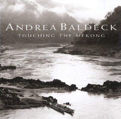 Andrea Baldeck touching the Mekong